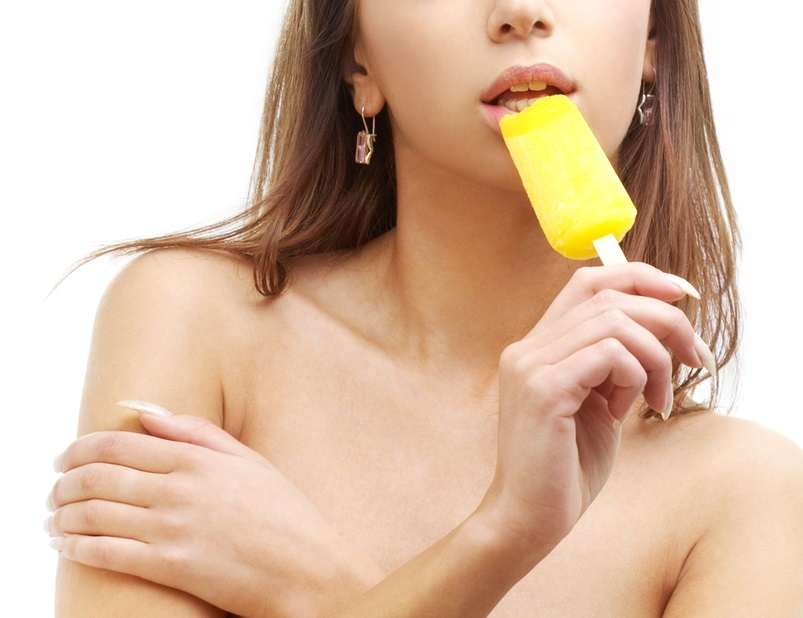 topless girl with yellow ice-cream over white