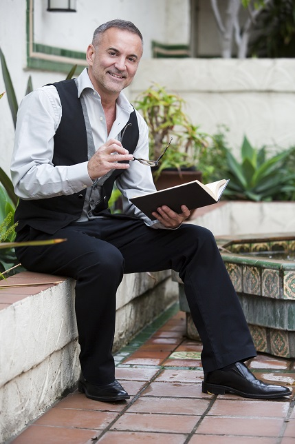businessman sitting outside and reading a book