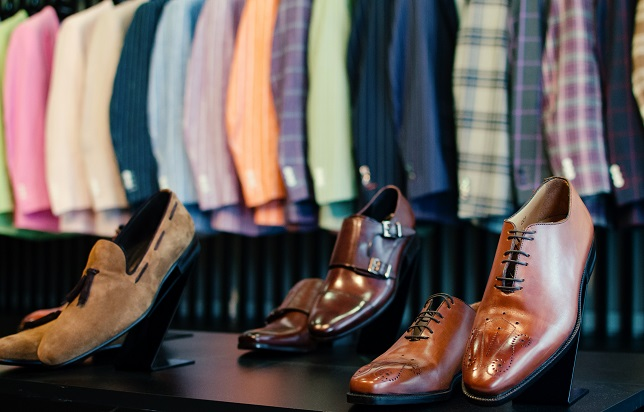 Shoes and suits in an elegant men fashion store